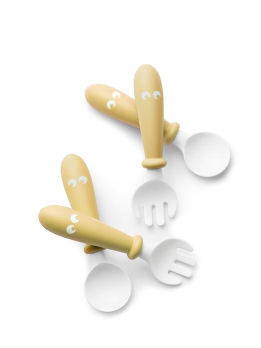Set lingurite si furculite pentru bebelusi 4 bucati Powder Yellow din categoria Alimentatie de la BabyBjorn